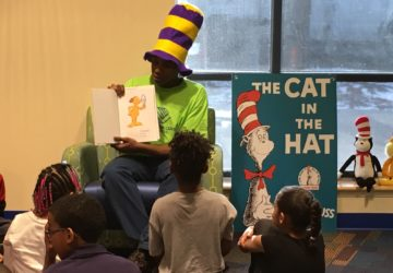 Club member reads to kids